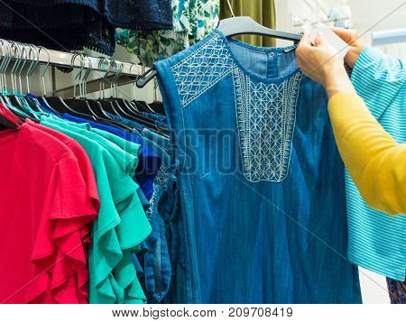 Unrecognizable Person In Clothes Shop