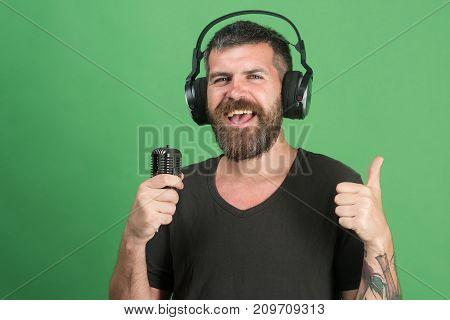 Pleasure, Music And Creative Lifestyle Concept. Dj With Beard