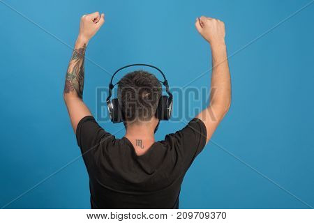 Relax And Music Concept. Singer With Beard Enjoys Music.