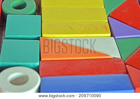 wooden colored blocks, construction game, part of a series, closeup