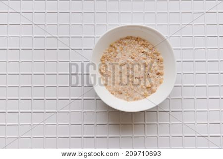 a plate of oatmeal on a white checkered background