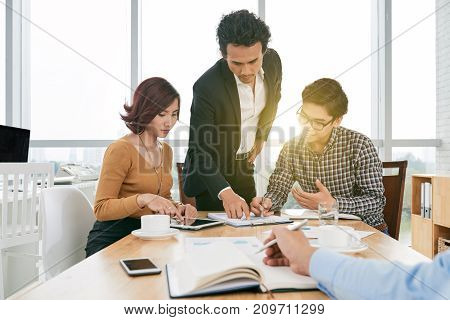 Financial managers analyzing information in month report