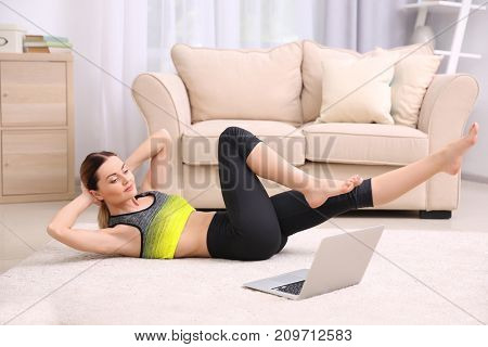 Young beautiful woman training at home