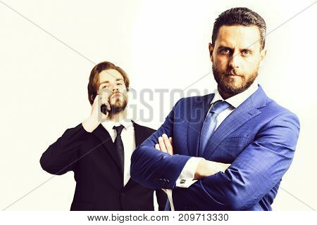 Serious Businessman In Blue Suit And Man Talking On Phone