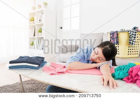 Beauty Mother Folding Clothing Getting Tired