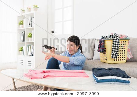 Cheerful Young Housewife Watching Funny Tv Program