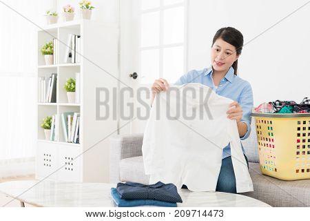 Happy Beautiful Woman Holding White Shirt