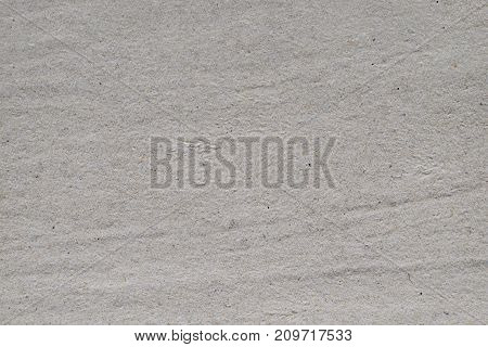 Background of gray crumpled strip of toilet paper.