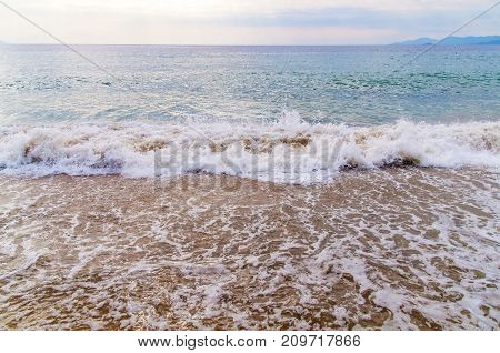 Foam wave on sea with beach background