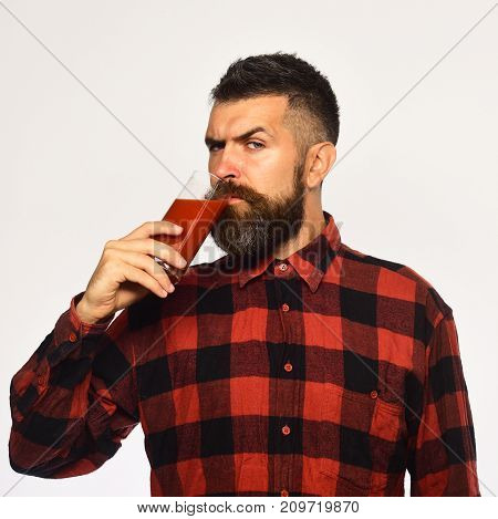 Farmer With Strict Face Holds Glass Of Fresh Red Juice.