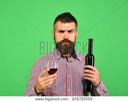 Man With Beard Holds Glass Of Red Wine