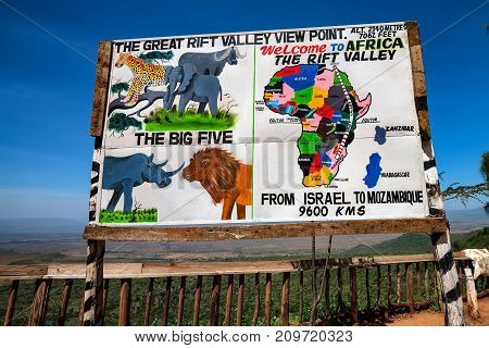 KENYA - DECEMBER, 2014: Sign of Great Rift Valley view point with map and animals