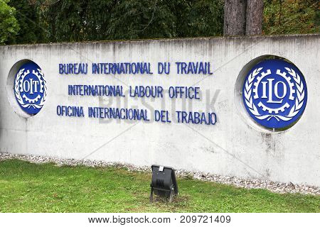Geneva, Switzerland - October 1, 2017: International labour office logo on a wall. ILO is a United Nations specialized agency which promotes international human and labour rights