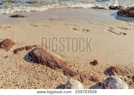 Footstep rock and sea with beach walk