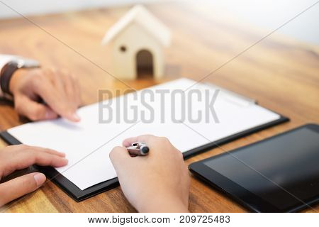 Customer Signing Contract, Agreed Terms And Approved Application And Analyzing Valuation Home Loan,