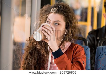 Girl Drinking Coffee In Bus