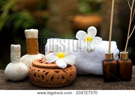 Thai Spa massage compress balls herbal ball and treatment spa relax and healthy care with flower Thailand. Healthy Concept.