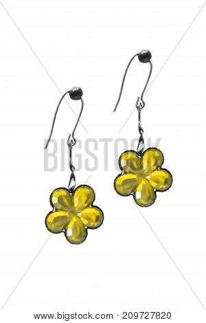 Yellow crystal flower shaped earrings isolated over white