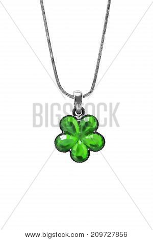 Green crystal flower pendant hanging on silver chain on white background