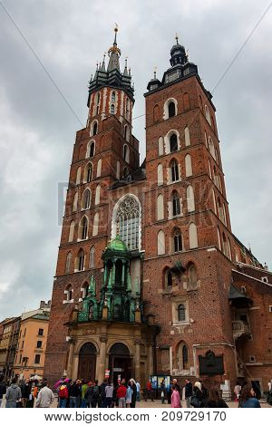 KRAKOW, POLAND - JUNE, 2012: Major tourist sight St.Mary's Basilica on main market square