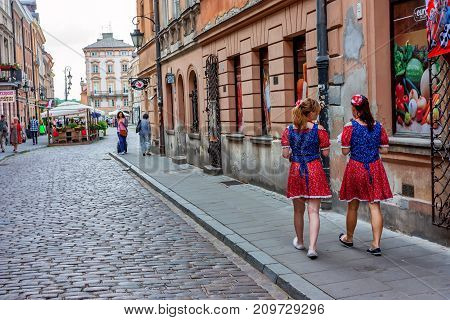 WARSAW, POLAND - JUNE, 2012: Beautiful historic streets of Warsaw, popular tourist city in Poland