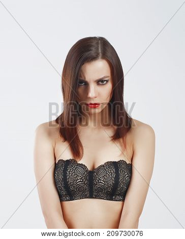 Gloomy irritated female making grimace showing wrath