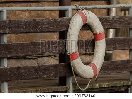 A rescue ring hangs on the bridge