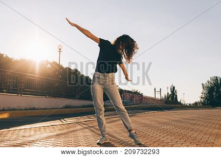 Beautiful Slender Girl With Curly Hair Dancing