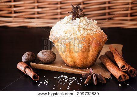 Pumpkin Oats streusel Muffins and spice nutmeg cinnamon anise. Wooden dark brown background. Selective focus. Copy space.