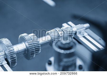 The pinion gear on the shaft in the light blue scene.The mechanical part for industrial.