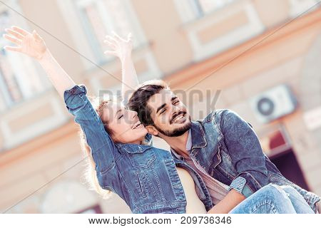 Young couple in love embracing happy smiling couple in love.