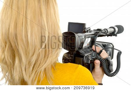 blond young woman with professional camcorder back view isolated on white