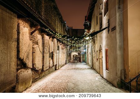 Tallinn, Estonia - December 3, 2016: Ancient Tombstones In St. Catherine's Passage From St. Catherine's Dominican Monastery At Night. Historic Centre Old Town Of Tallinn. UNESCO World Heritage Site
