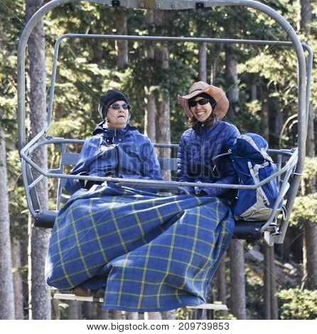 FLAGSTAFF, ARIZONA, OCTOBER 10. Arizona Snowbowl on October 10, 2017, near Flagstaff, Arizona. A Pair of Women Ride Arizona Snowbowl's Scenic Chairlift in the San Francisco Peaks near Flagstaff Arizona.