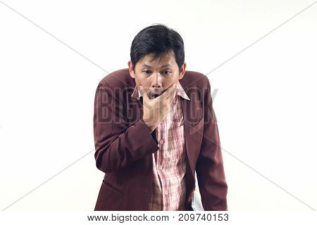 Asian Businessman With Hands On Face And Shocked Over White Background