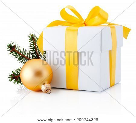 White gift box tied yellow ribbon and Christmas bauble Isolated on white background