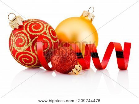 Three Christmas baubles and curling paper isolated on white background