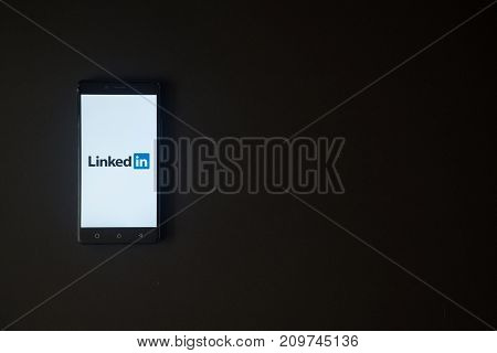 Los Angeles, USA, october 19, 2017: Linkedin logo on smartphone screen on black background.