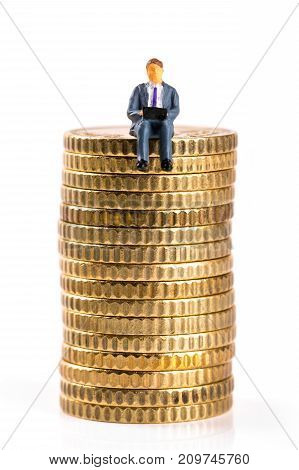 successful businessman sitting on money stack. isolated on white background