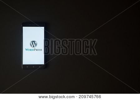 Los Angeles, USA, october 19, 2017: Wordpress logo on smartphone screen on black background.