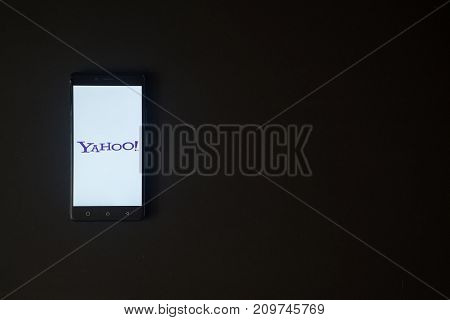 Los Angeles, USA, october 19, 2017: Yahoo logo on smartphone screen on black background.