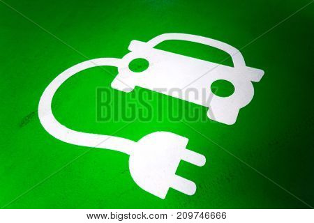 Green And While Electric Car Charging Station Symbol.