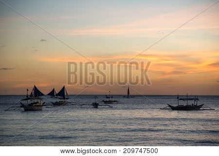 Evening sunset of the sea with ships on the water. Malay, Philippines