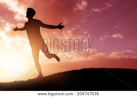 Athlete man posing after victory against cloudy sky landscape