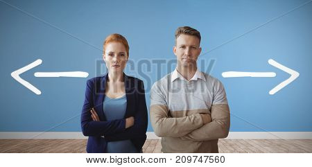 Business people looking at camera against room with wooden floor