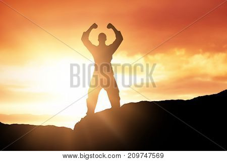 Fighter posing after victory against scenic view of sea against sky during sunset