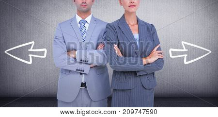 Business people with arms crossed looking at camera against grey room