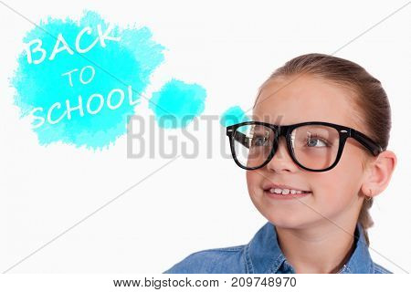 Cute pupil smiling against digital composite image of text on blue spray paint