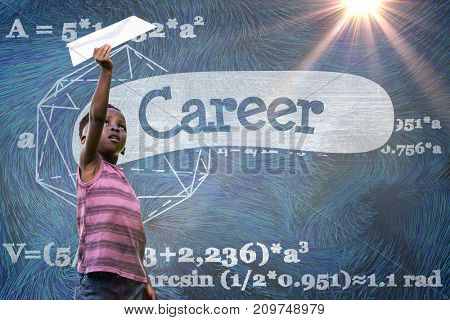 Boy holding paper airplane against career against black background