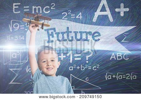 Portrait of boy holding wooden toy airplane against future against blue chalkboard